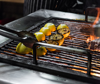 Lemons being charred on the grill